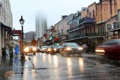 New Orleans cityscape during rainy day. Decatur street view with French Quarter, Downtown buildings in a fog and cars in a motion on a wet road. Spring rain in stock image