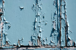 Decay. Peeling paint on the front of an old door stock photos