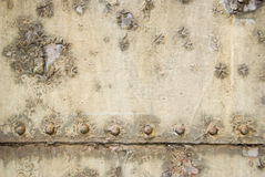 Decay texture. Rivets and peeling paint Stock Images