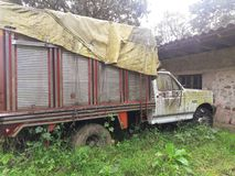 Decay of a transport vehicle. Standing in a garden and overgrown with plants Royalty Free Stock Images