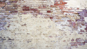Decay wall mixed with brick  horizontal. Decay wall mixed with brick background horizontal in Venice, Italy Royalty Free Stock Photography