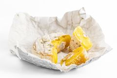 Decayed Camembert Cheese on white background stock photography