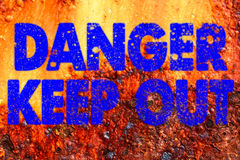 Decayed danger keep out sign Stock Photography