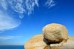 Decayed granite rock as ball, Fujian, China. Weathering and decayed granite under blue sky in Fujian, South of China, as featured geology landforms, with Stock Photography