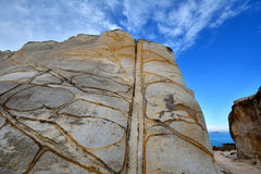 Decayed granite rock by seaside. Weathering and decayed granite under blue sky in Fujian, South of China, as featured geology landforms, with wonderful pattern stock photography