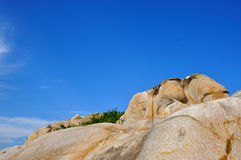 Decayed granite under blue sky. Weathering and decayed granite under blue sky in Fujian, South of China, as featured geology landforms, with wonderful pattern Royalty Free Stock Photography