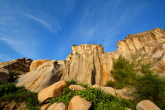 Decayed granite under blue sky. Weathering and decayed granite under blue sky in Fujian, South of China, as featured geology landforms, with wonderful pattern Royalty Free Stock Image