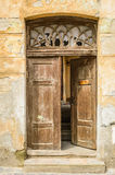 Decayed opened door. With broken glass in daylight Royalty Free Stock Image