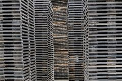 Decayed piles of wooden planks stacked. Old stacked wooden plank towers Royalty Free Stock Photos