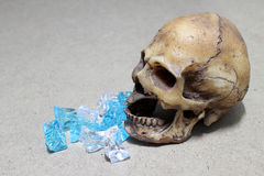 Decayed teeth human skull with candy on wood background. like a people eating candy too much. Stock Image