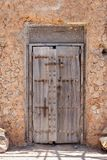 Decayed wooden door with old carvings Stock Image