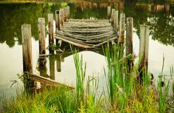 Decayed Wooden Pier in Lake Royalty Free Stock Images