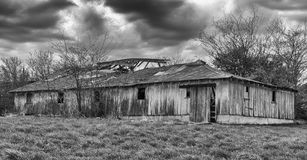 Decaying barn in a rural area. Decaying barn on a farm in rural Indiana with a storm moving in Stock Photo