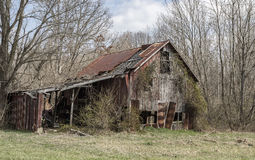 Decaying Barn. Barn in rural area among trees Stock Photography