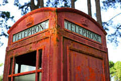 Decaying British telephone booth. This old British telephone booth is a reminder of a largely bygone communications era Stock Photo