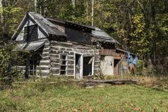 Decaying cabin. Decaying cabin in a rural area royalty free stock photo