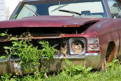 Decaying Car. An old abandoned, rusting and decaying car Stock Images