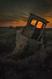 Decaying Fishing Boat. The old fishing boat rots into Thornham saltmarsh as the sunsets Stock Photos