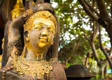 Golden wooden statue in Lamphun Stock Photography