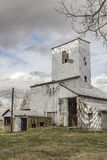Decaying Grain Elevator. On a rural road royalty free stock photos