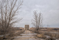 Decaying highway leading to abandoned bridge Stock Photos