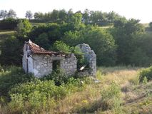 Decaying house in nature Royalty Free Stock Photo