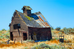 Decaying old wooden Barn. An old wooden barn sagging under the weight of decay in rural Oregon Royalty Free Stock Images