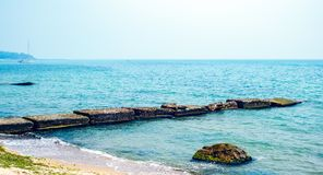 Decaying pier. Blue ocean and clear sky royalty free stock photos