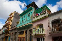 Decaying and renovated buildings in Old Havana City,  Cuba. Havana,Cuba - January 22,2017: Decaying and renovated buildings on the main street in Old Havana City Royalty Free Stock Photography