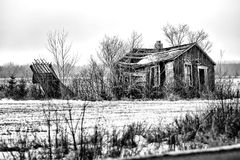 Decaying Shack. An old decaying shack on farm land in black and white Stock Photos