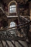 Decaying staircase in an abandoned house.  stock photo