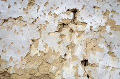 The Decaying Wall. Artistic close up shot of a decaying house wall made of clay stock photo