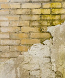Decaying wall. With plaster odpadajÄ…cym as a sign of neglect or lack of finances to rebuild or repair stock photography