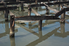 Decaying Wharf Pilings along the Sea Coast Stock Photography