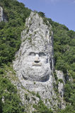 Decebal head carved in rock at Cazane Gorge,Romania royalty free stock photo