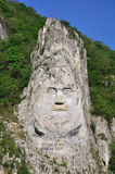 Decebal's head carved in rock Stock Image