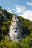 Decebalus rock sculpture. The rock sculpture of Decebalus is a 40-m high carving in rock of the face of Decebalus, the last king of Dacia, who fought against the Stock Photography