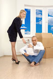 Deceit. The woman allows to the man to sign papers in new apartment Stock Photo