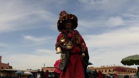 Free December 14 2015. Morocco, Marrakech. Main Square Of Marrakesh - Snake Charmers, Musicians And Water Carrier - 3 Videos Sequence Royalty Free Stock Photo - 74088525