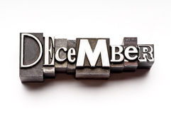 December. The month of December done in letterpress type on a white paper background