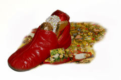 December 6th goodies. Vintage child's slipper filled with chocolate, candy from Knecht Ruprecht atop advent calendar with 6 December window open; German/European Stock Photo