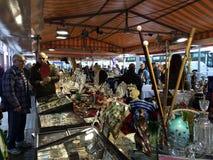 2015 December, Barcelona- visitors examines flea market on placa Catalunia,. Visitors examines content of store in flea market on Barcelona royalty free stock image