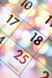 December calendar. Blending with bright Christmas lights Stock Photography