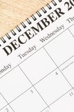 December on calendar. Close up of spiral bound calendar displaying month of December Stock Images
