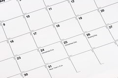 December Calendar. Close-up of a December calendar showing Christmas Eve, Christmas Day, Boxing Day and New Year's Eve. Customized message can be put in the stock image