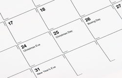 December Calendar. Close-up of a December calendar showing Christmas Eve, Christmas Day, Boxing Day and New Year's Eve.  Customized message can be put in the Royalty Free Stock Photos
