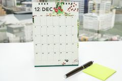 December calendar with mock up postit and pen for meeting note royalty free stock photography