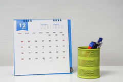 December calendar on office desk with stationary box Stock Images