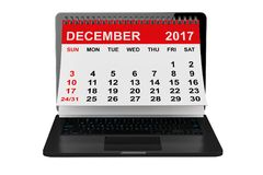 December 2017 calendar over laptop screen. 3d rendering. 2017 year calendar. December calendar over laptop screen on a white background. 3d rendering Stock Photos