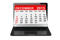 December 2015 calendar over laptop screen. 2015 year calendar. December calendar over laptop screen on a white background Stock Image